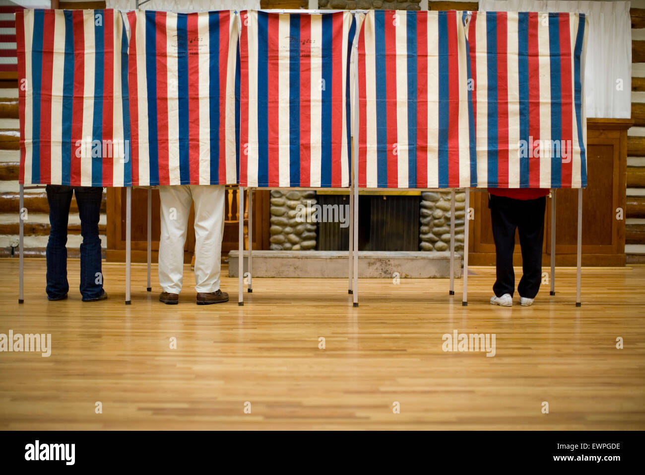 Local citizens casting their vote on Election Day - Stock Image