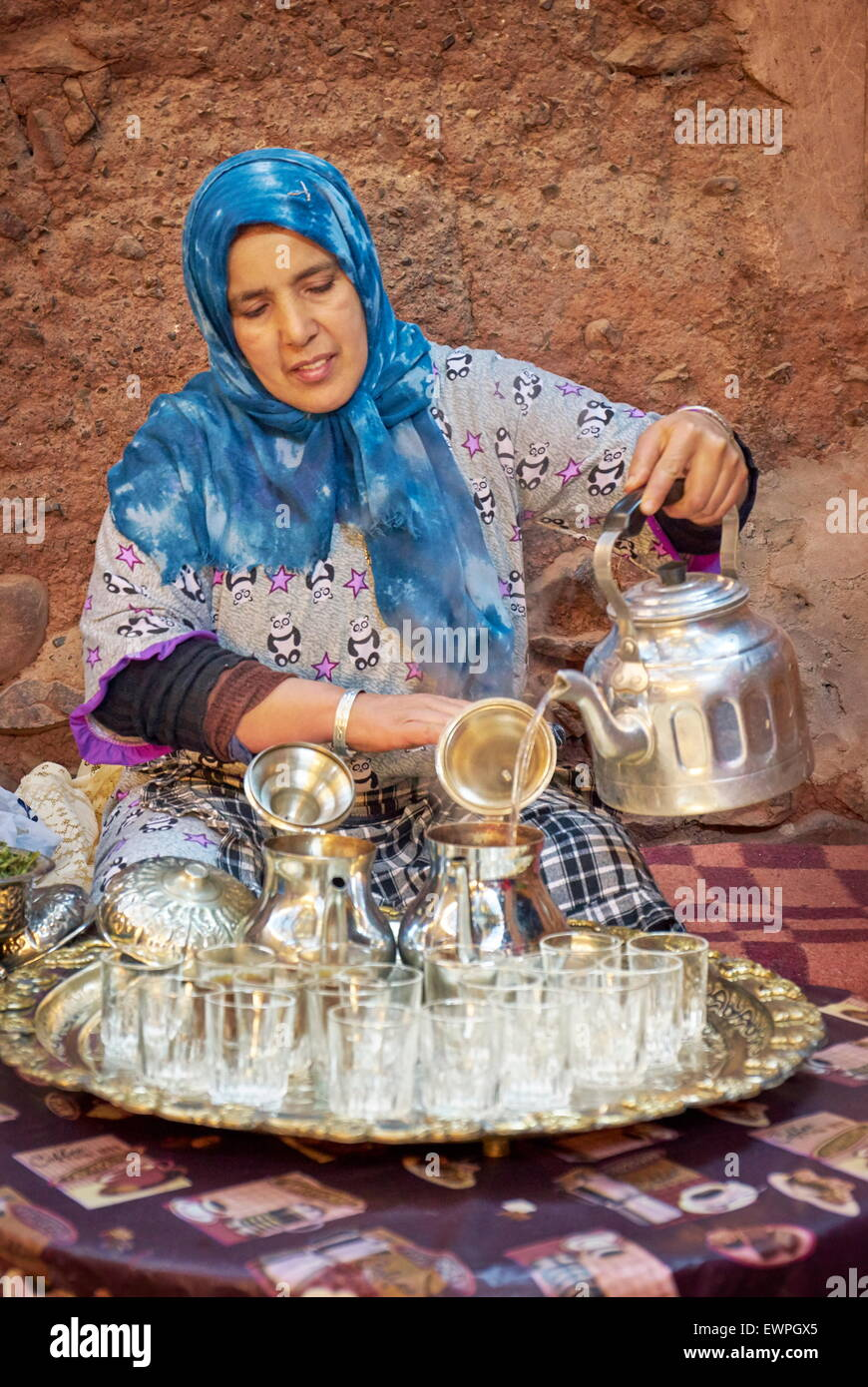 Traditional tea ceremony. Berber women preparing tea with mint and verbena. Ourica Valley, Morocco Stock Photo