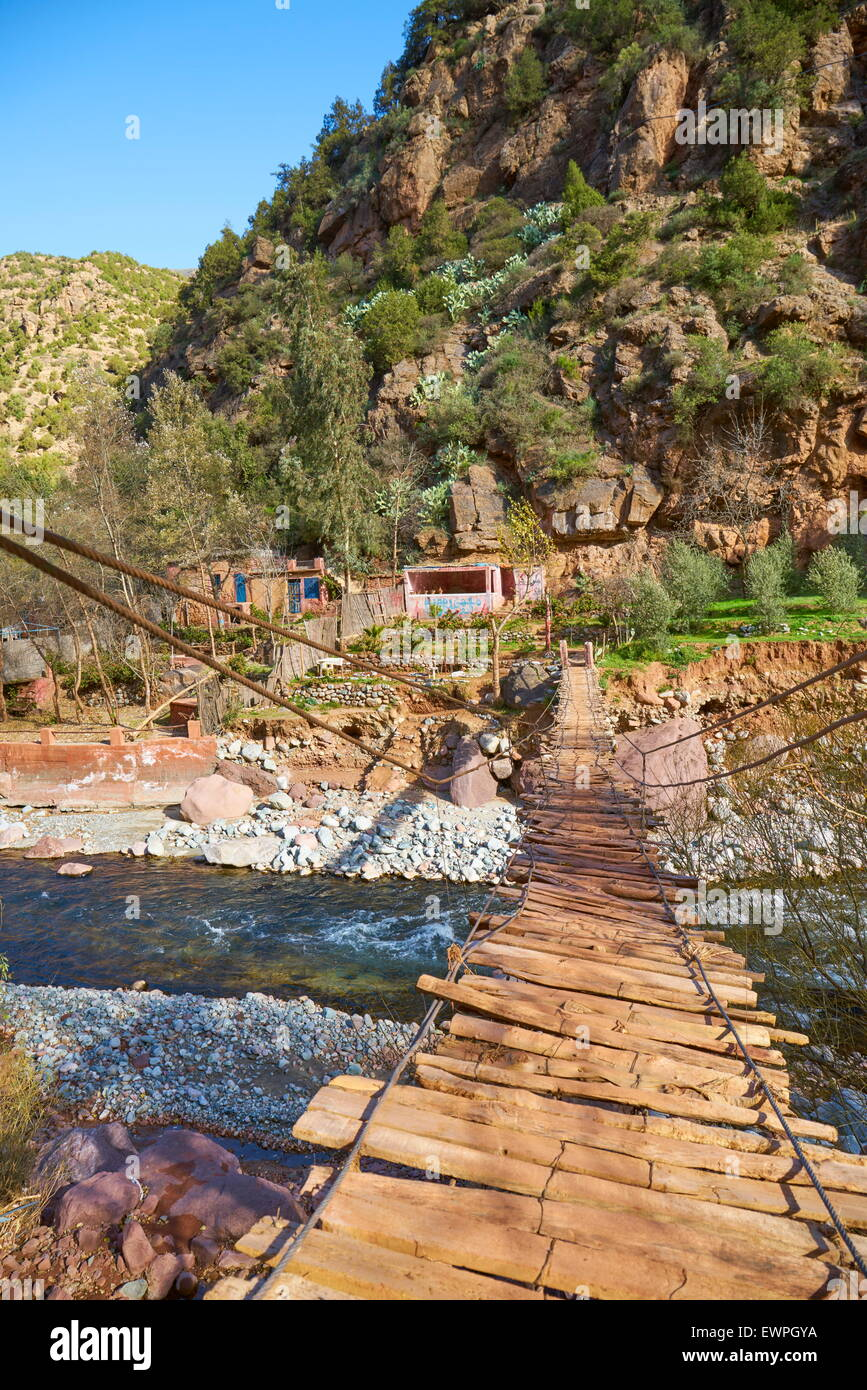 Ourika Valley. Wooden rope bridge over the river. Morocco - Stock Image