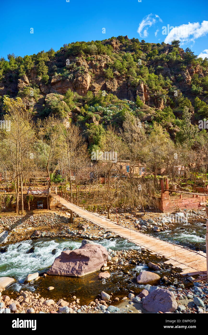 Wooden bridge over the river, Ourika Valley, Morocco, Africa - Stock Image
