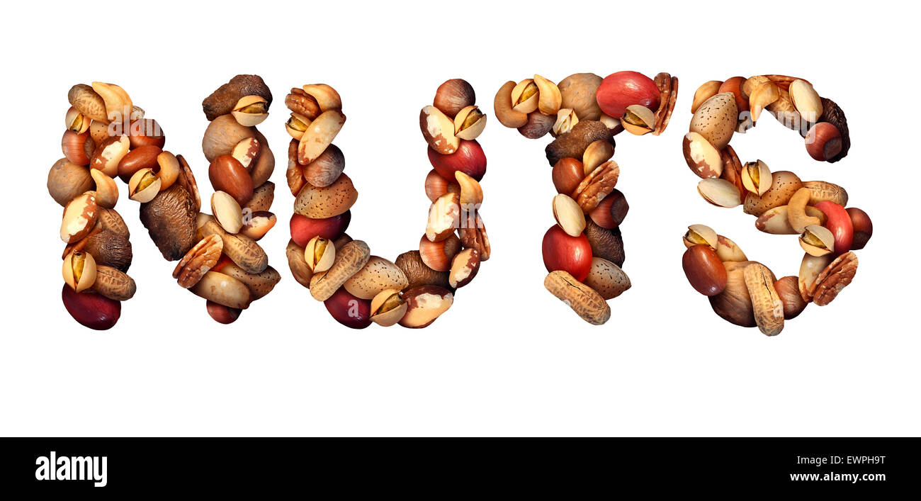 Nuts symbol as letters made with a mixed assortment of raw seeds pecan with walnut brazil nut peanut,hazelnut pistachio - Stock Image