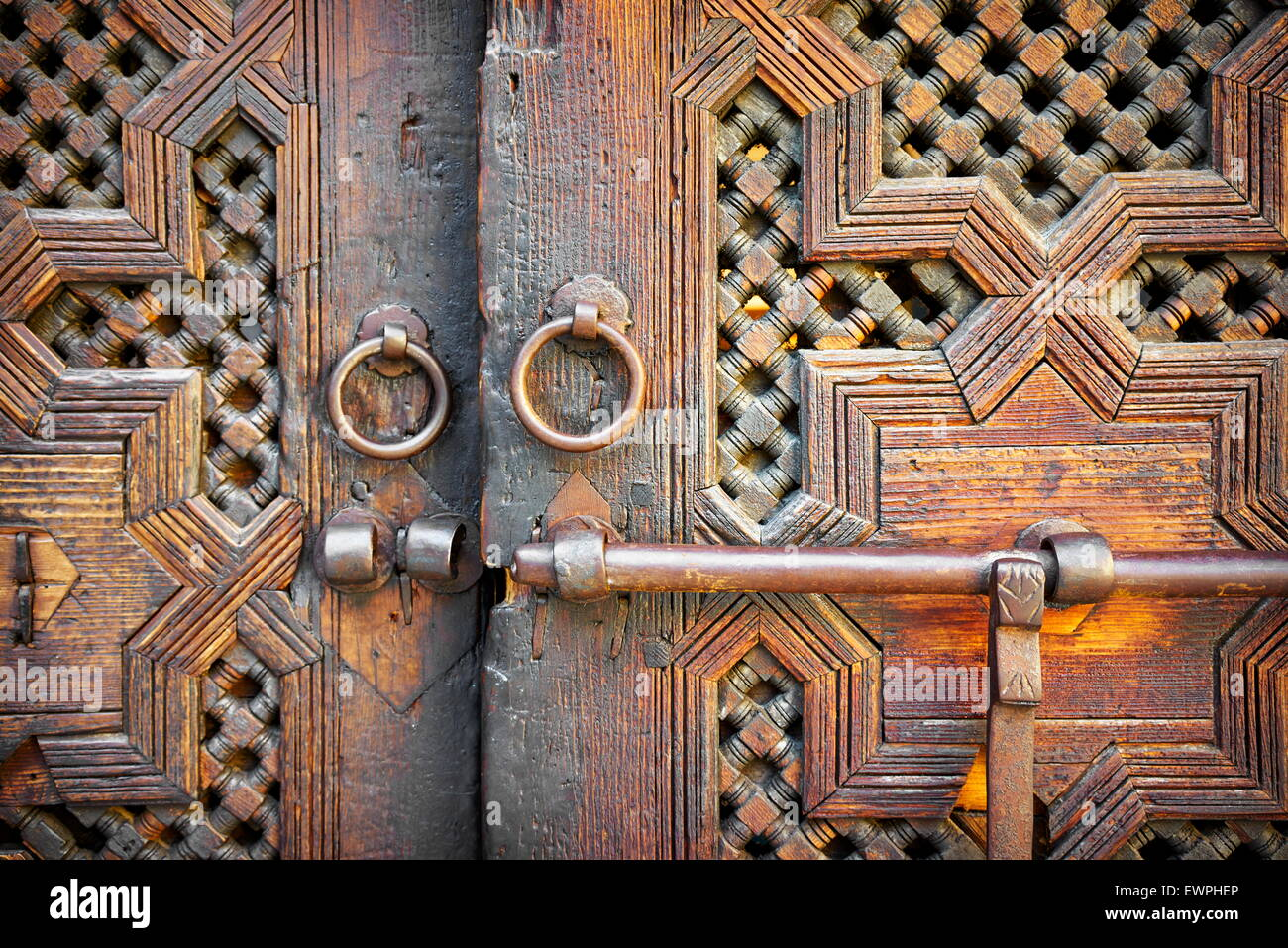 Fez. Historic wooden door in old house, Medina. Detail of the decorative ornament. Morocco, Africa - Stock Image
