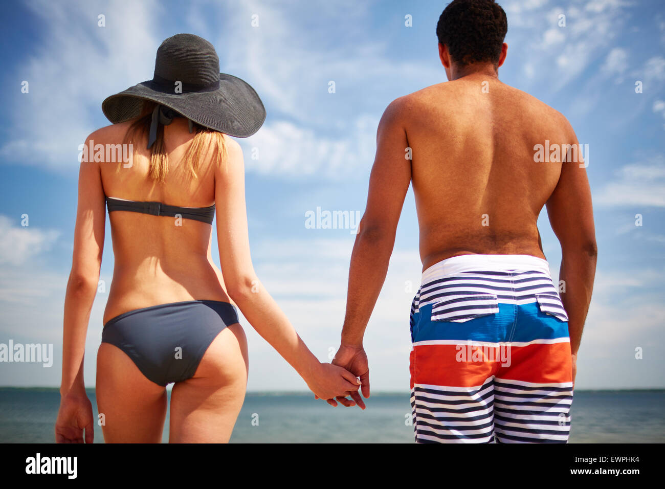 Restful couple in swimwear spending vacation by the sea Stock Photo