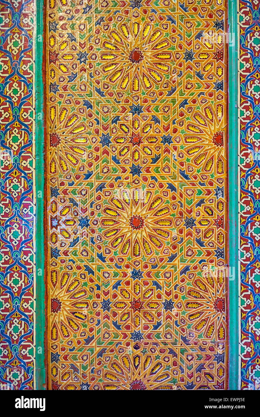 Ornate, carved and painting door  to a mosque. Morocco - Stock Image