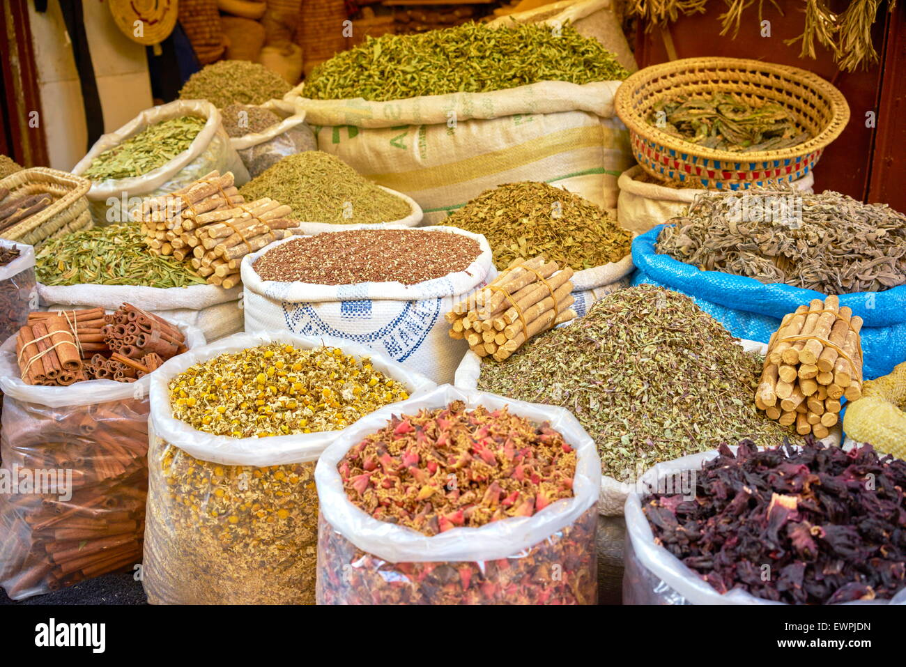 Sacks of dried flowers, rose petals, buds and herbs in the souk. Morocco - Stock Image