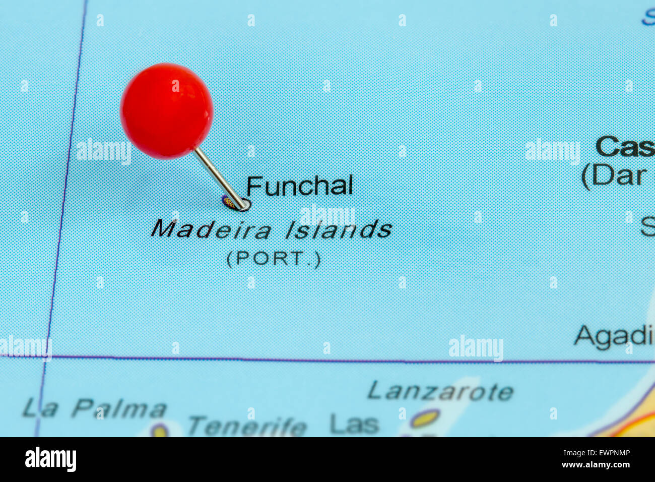 Close-up of a red pushpin on a map of Funchal, Madeira Islands, Portugal - Stock Image