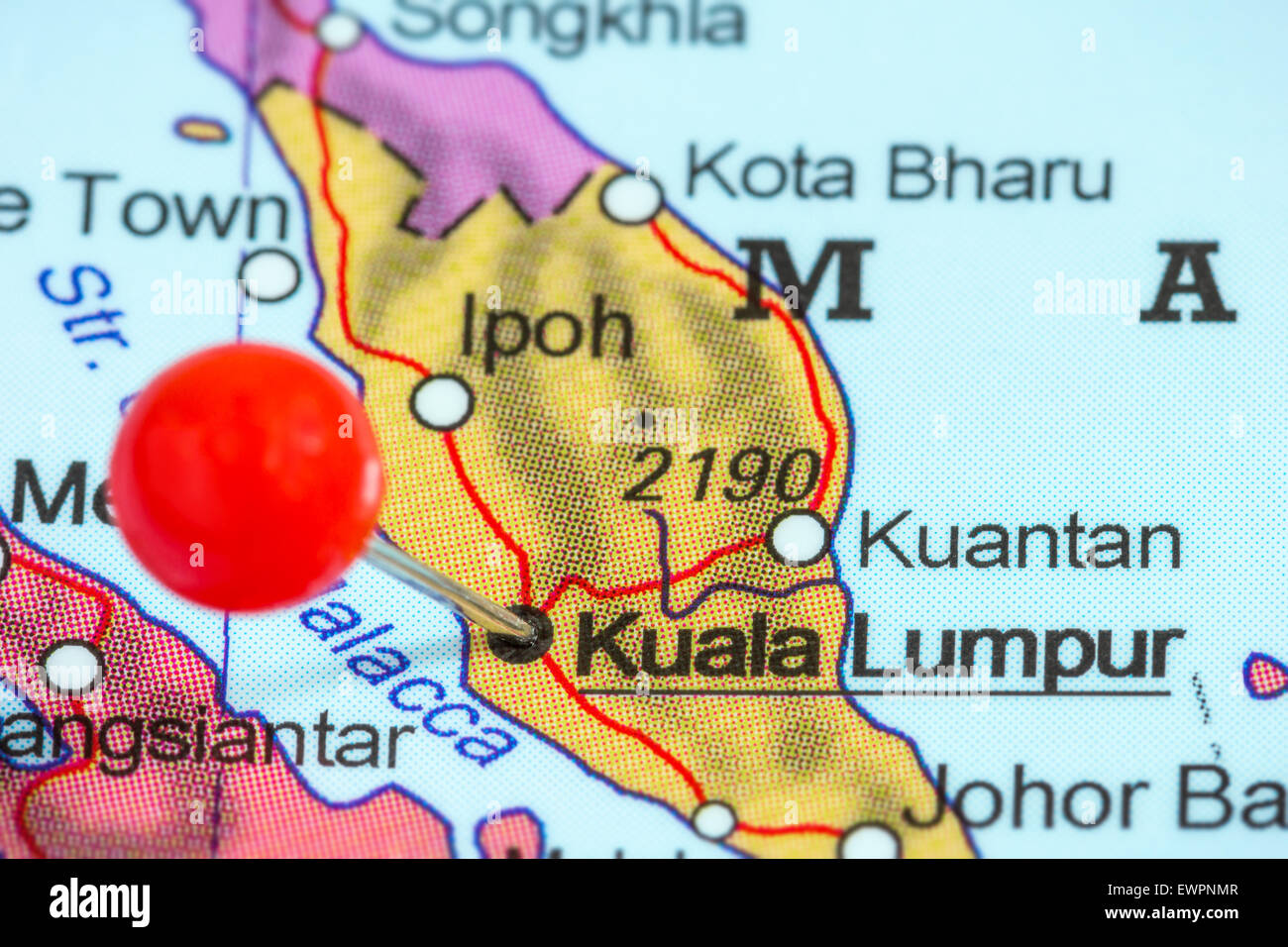 Close-up of a red pushpin on a map of Kuala Lumpur, Malaysia - Stock Image