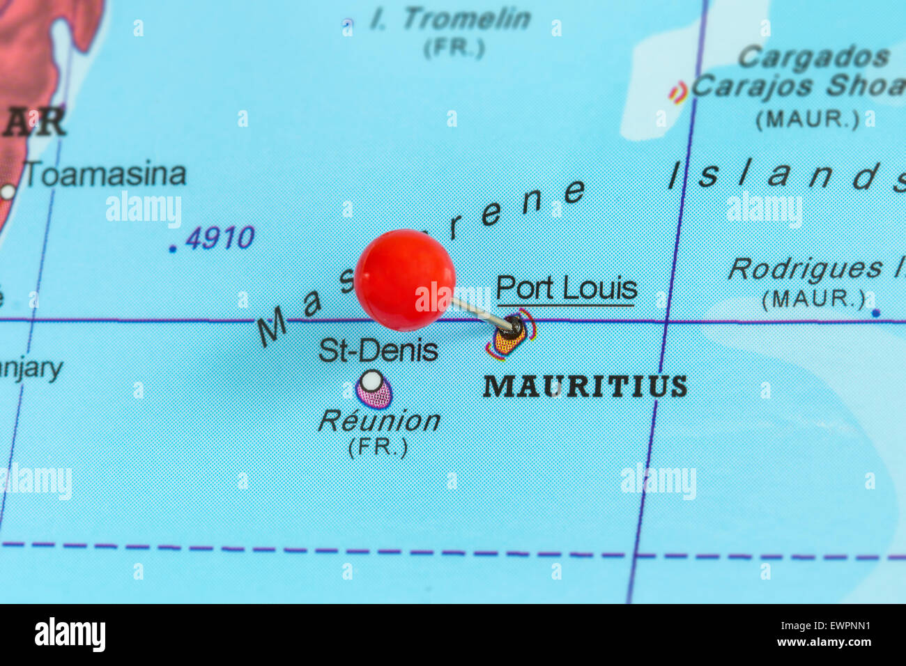 Close-up of a red pushpin on a map of Port Louis, Mauritius Stock Photo