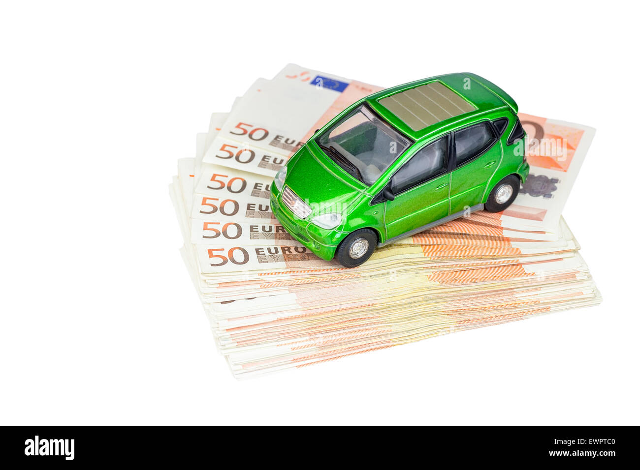 Green model car on stack of euro notes as symbol for buying or costs - Stock Image