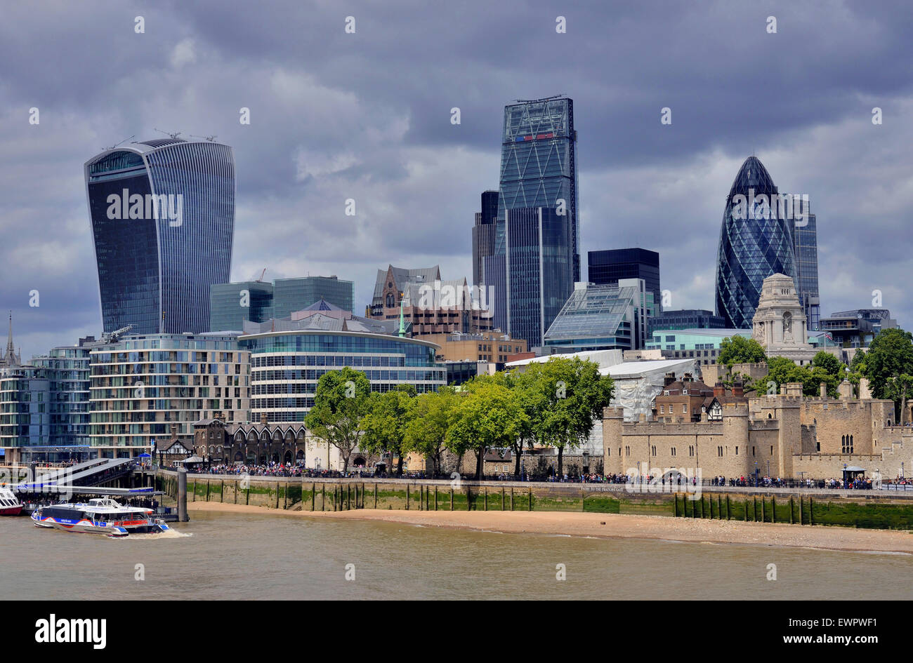 Skyline of the financial district, City of London, Tower of London on the right, The Gherkin behind, London, England - Stock Image