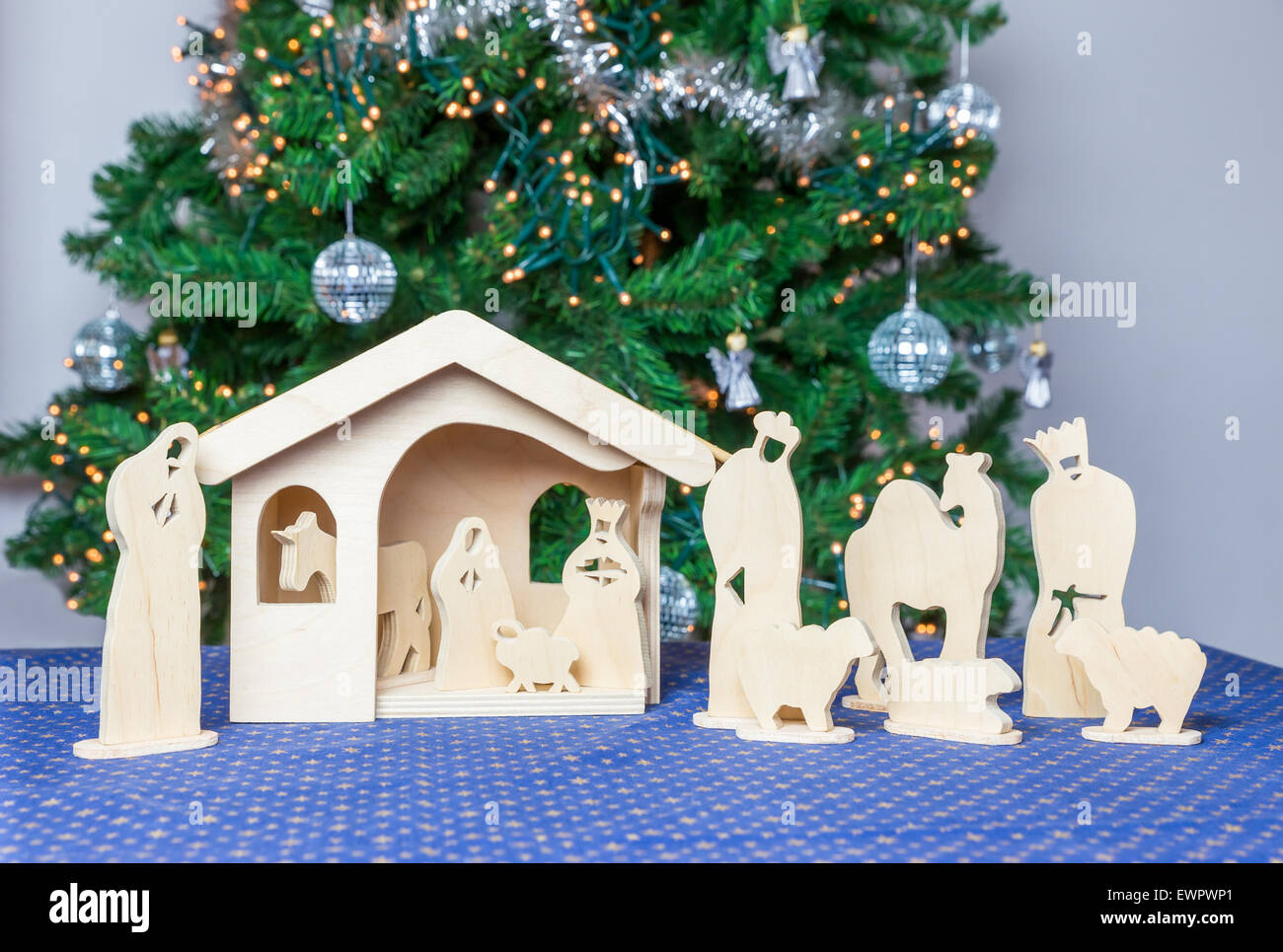 Christmas Stable Background.Wooden Christmas Stable With Bible Figurines And Tree On