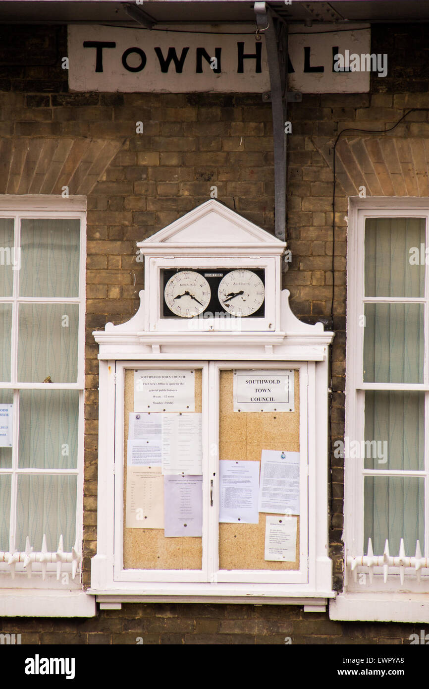 Southwold town hall noticeboard and clocks - Stock Image