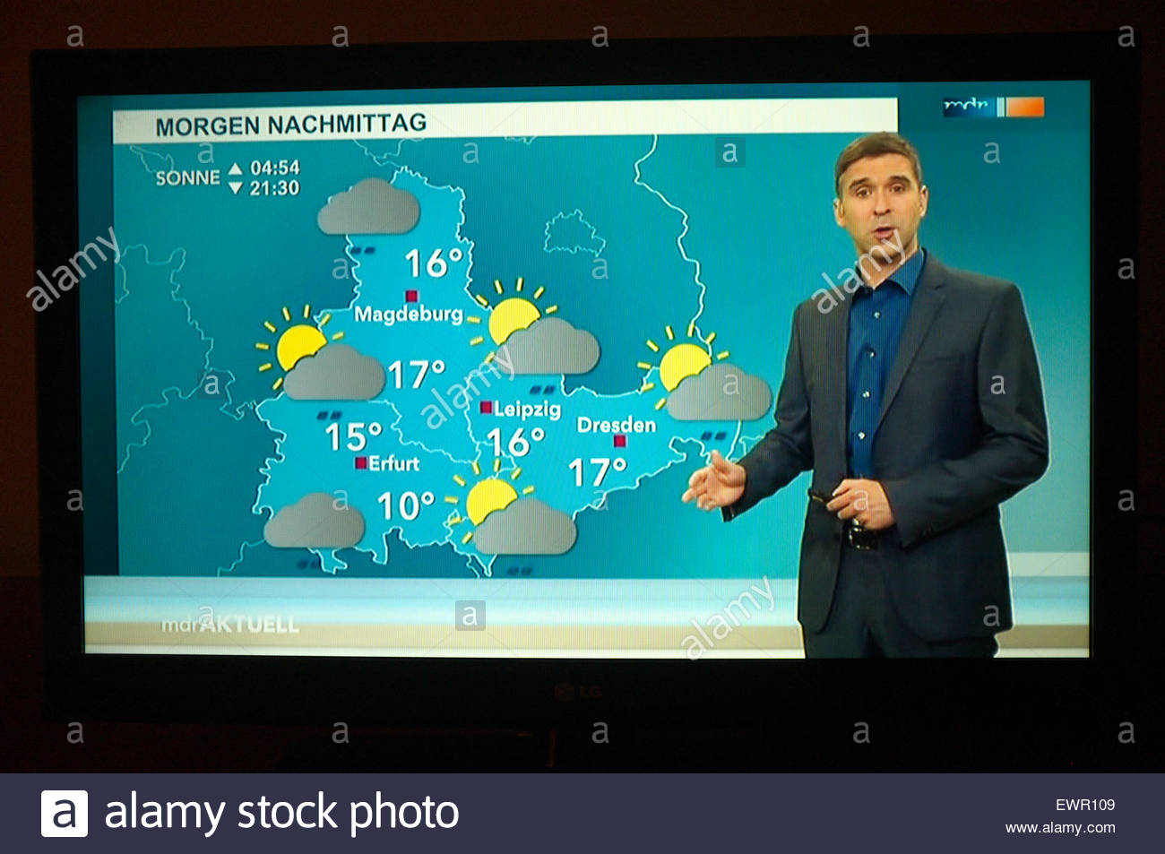 Television picture - presenter giving a weather forecast for part of the eastern side of Germany. - Stock Image