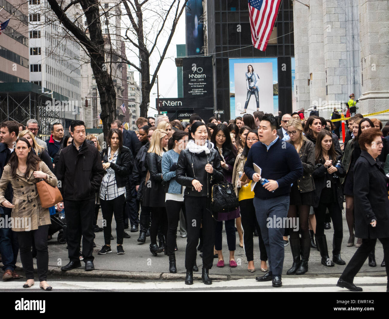 Crowed pavement on New Yorks Fifth Avenue Stock Photo