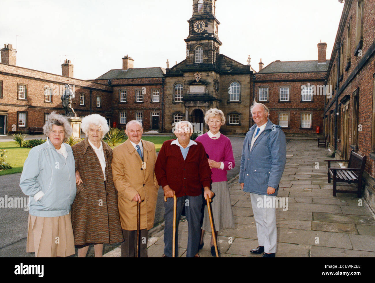 Residents of the Sir William Turner Hospital with Alan Wordsworth, right, clerk to the trustees. 3rd November 1991. - Stock Image