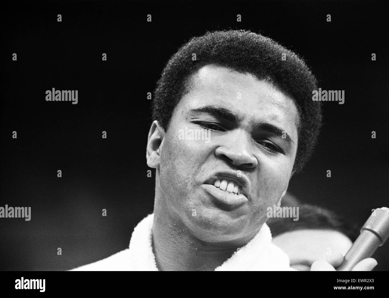Muhammad Ali talking to the press in his training camp ahead of his first fight with Joe Frazier. 1st December 1972 - Stock Image