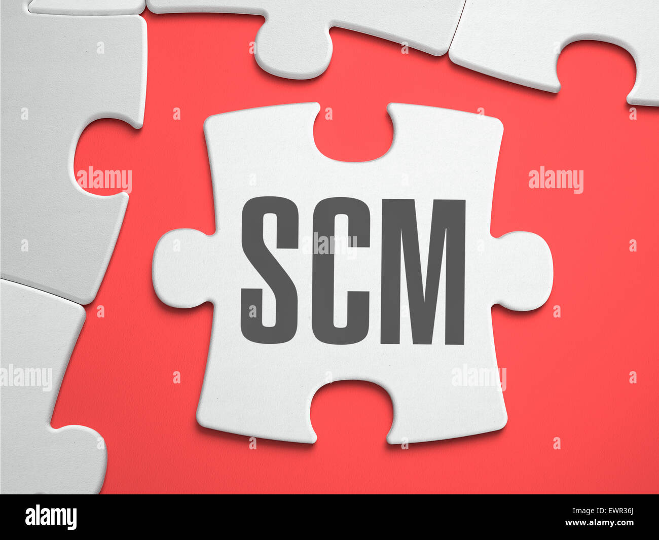 SCM - Supply Chain Management - Supply Chain Management - Text on Puzzle on the Place of Missing Pieces. Scarlett Stock Photo