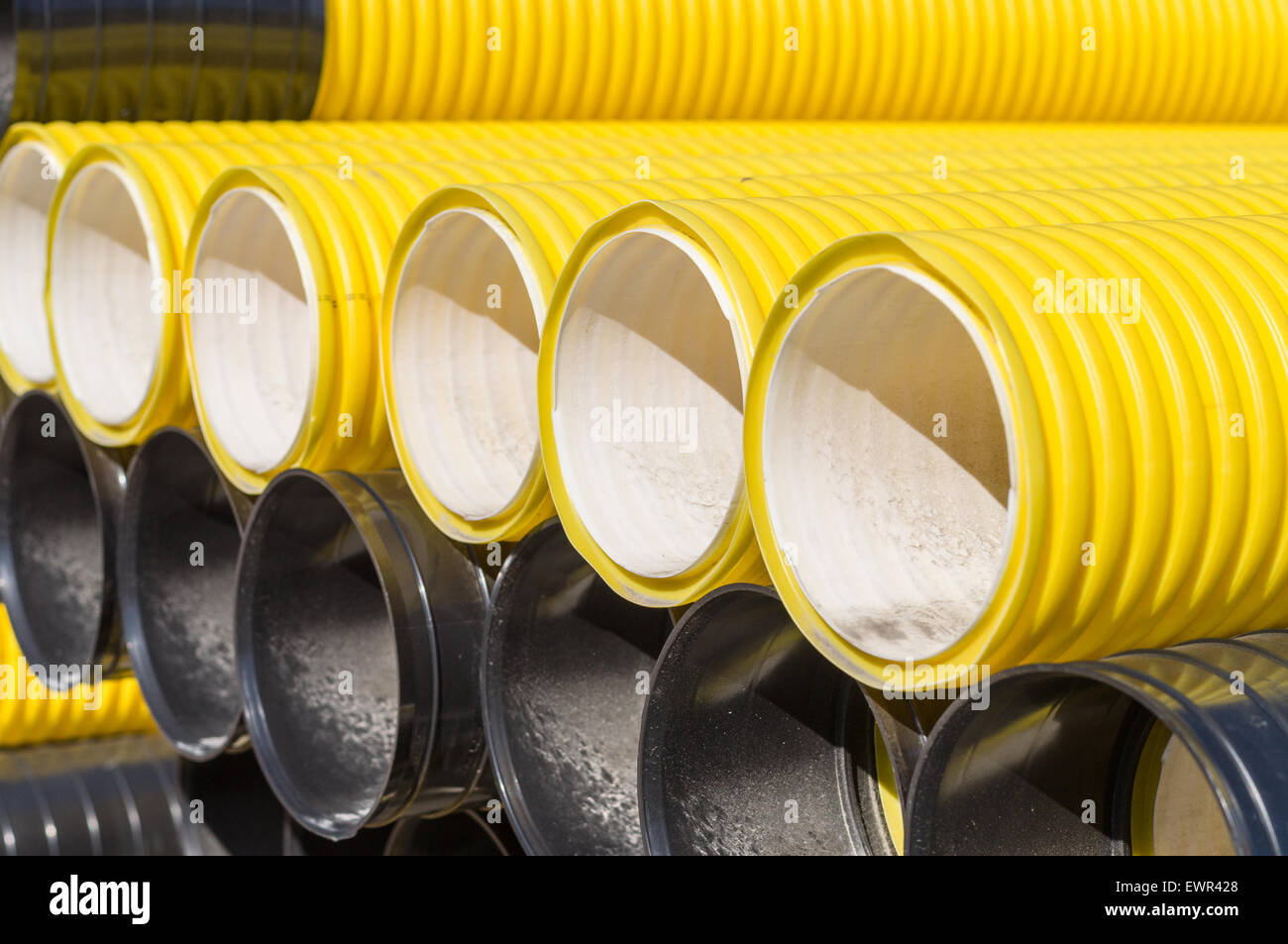 Stack of corrugated plastic pipes - Stock Image