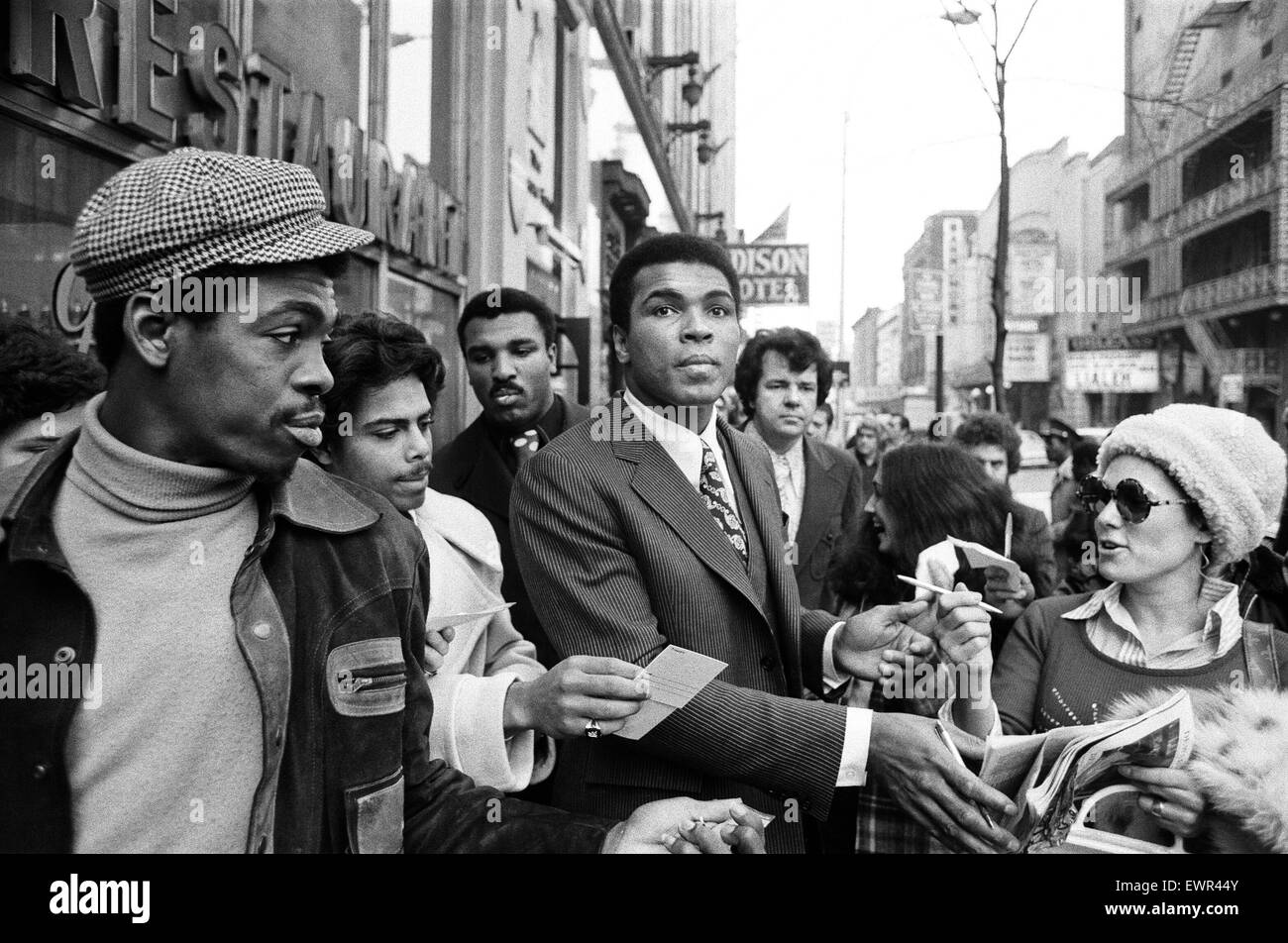 Muhammad Ali signing autographs ahead of his rematch with Joe Frazier. 23rd January 1974 - Stock Image