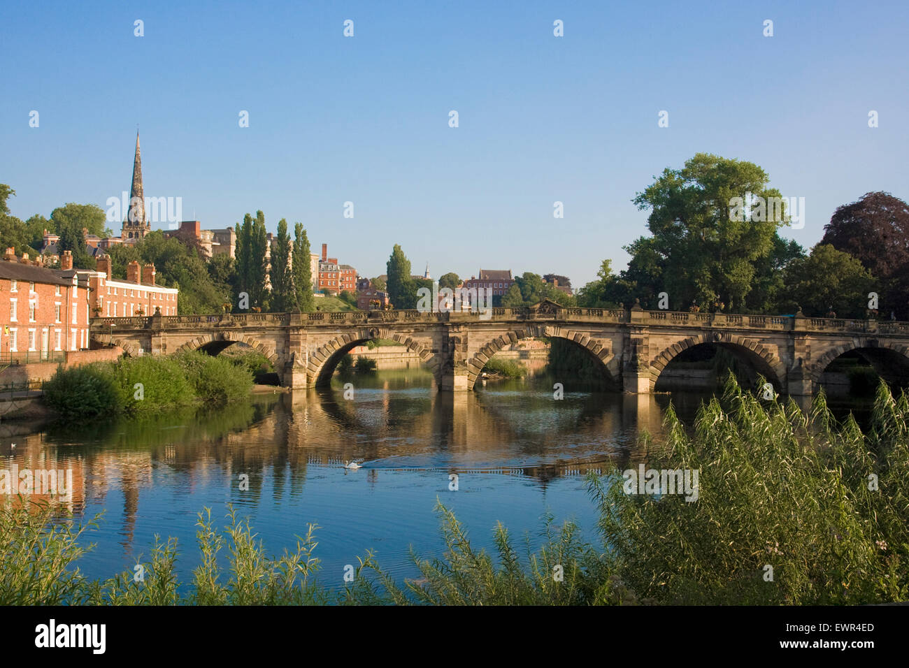 Under clear blue skies, English Bridge crosses the River Severn in Shrewsbury, Shropshire. Picture taken early in - Stock Image