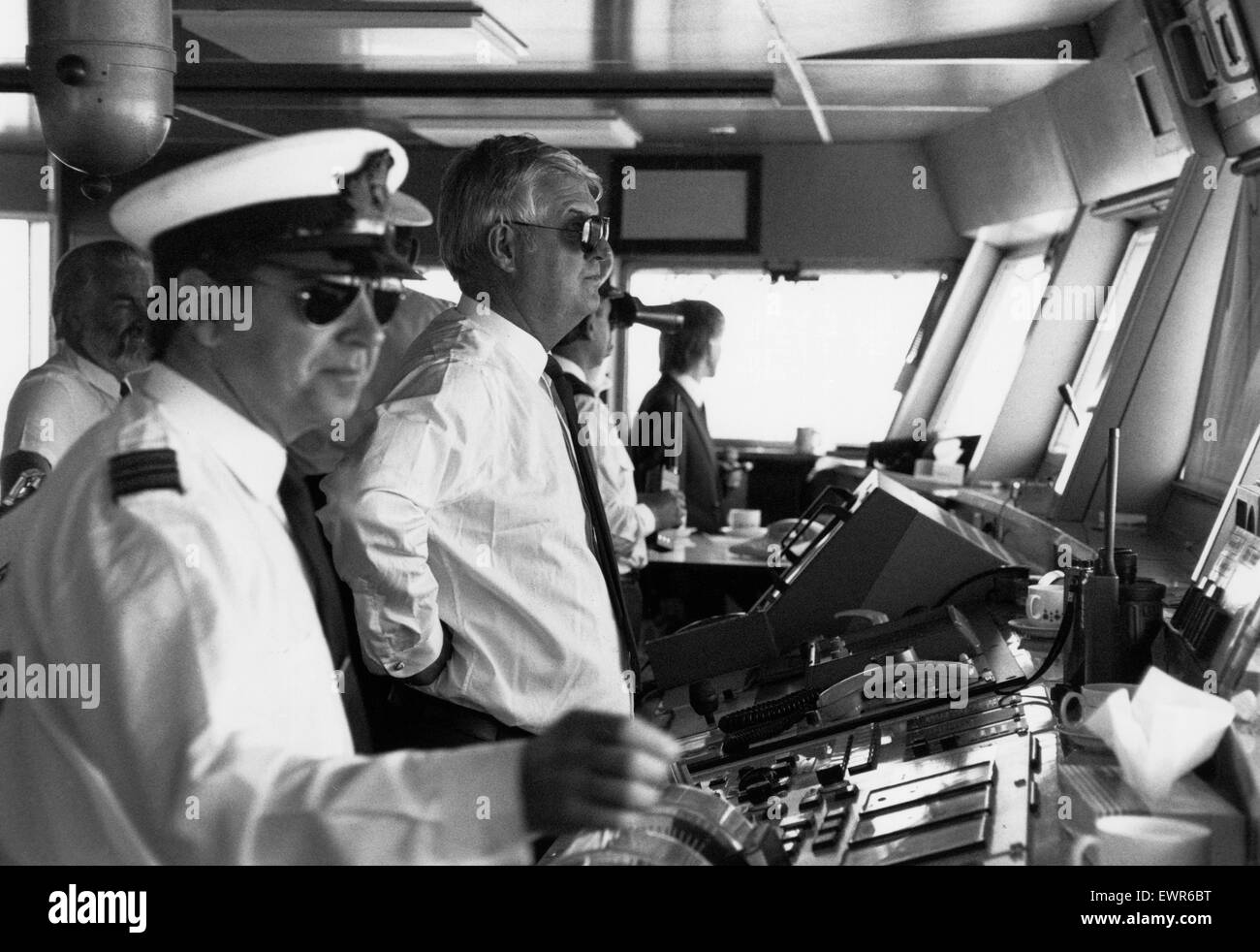 Captain Robin Woodall, Master of the QE2, on the bridge of the ship as it is sailed into Liverpool as part of Cunard's - Stock Image