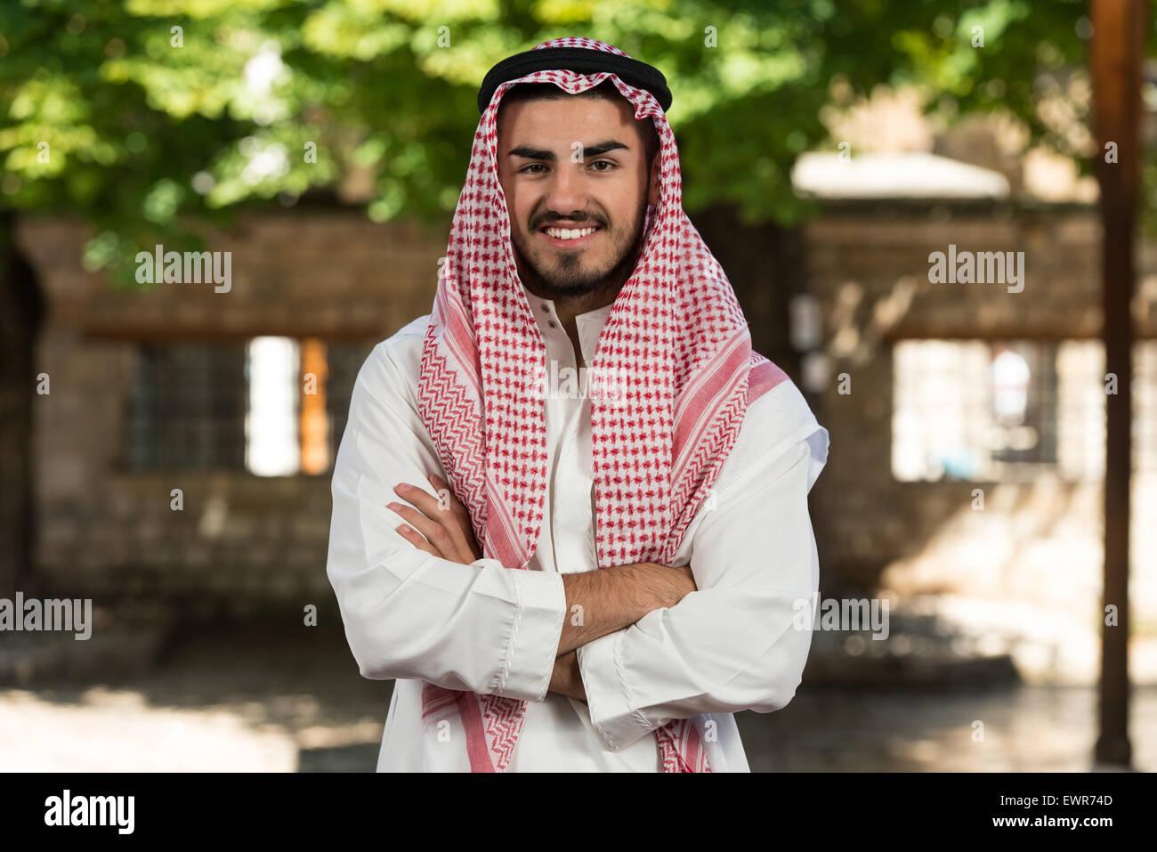 Young Businessman Wearing A Traditional Cap Dishdasha Stock Photo