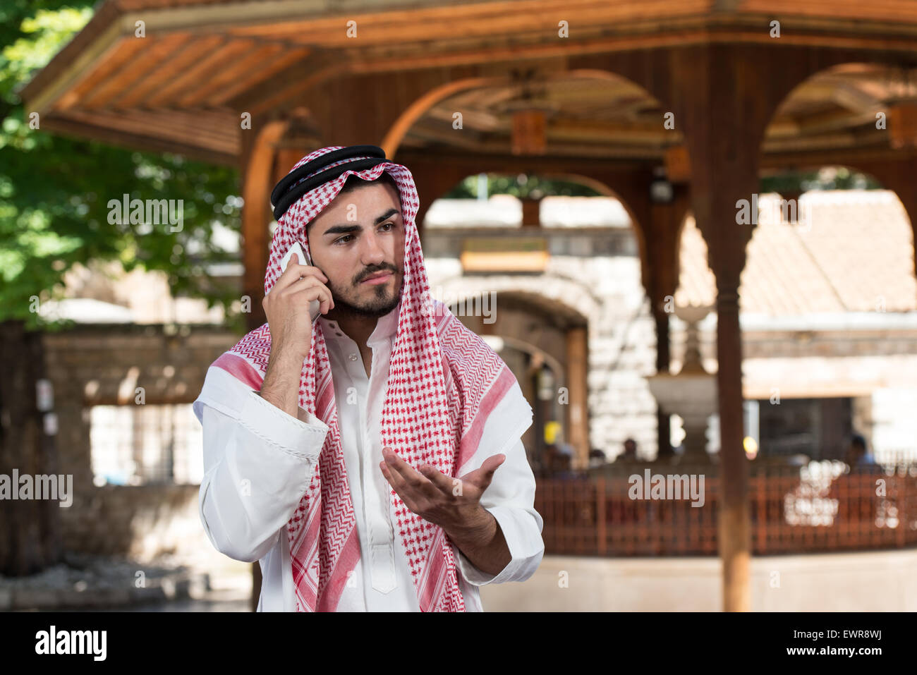 Young Businessman Wearing A Traditional Cap Dishdasha Stock Photo