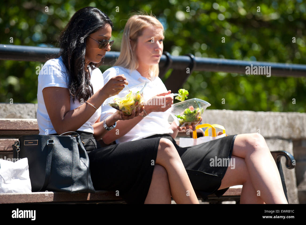 London, UK. 30th June 2015. Two young women eat salad near The Embankment. Credit:  Graham M. Lawrence/Alamy Live - Stock Image