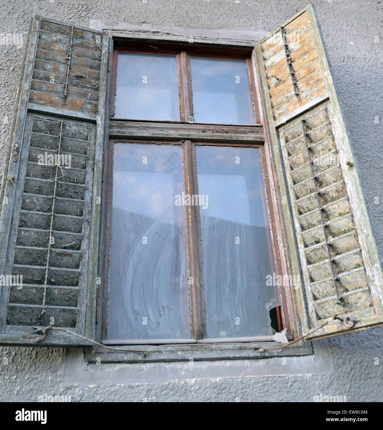 Old wooden shuttered window in Sibiu, Romania - Stock Image