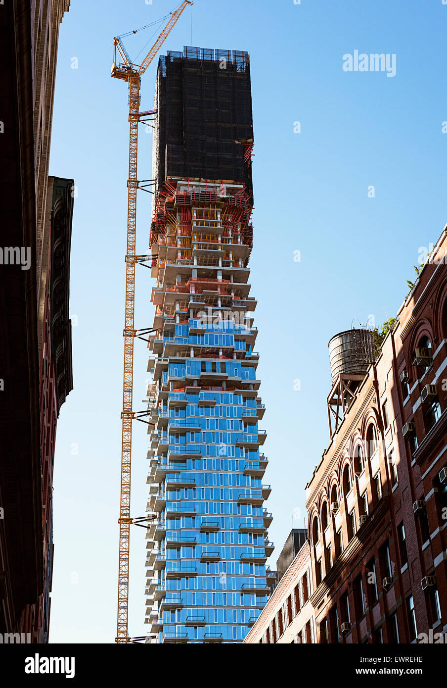 Building real estate in New York city. The building of the 56 Leonard Street Condos in the Tribeca neighborhood Stock Photo