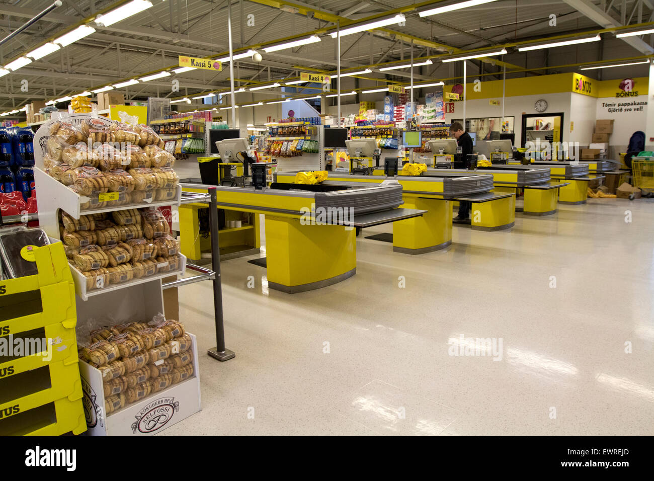 checkouts and tills of interior of bonus supermarket Iceland - Stock Image