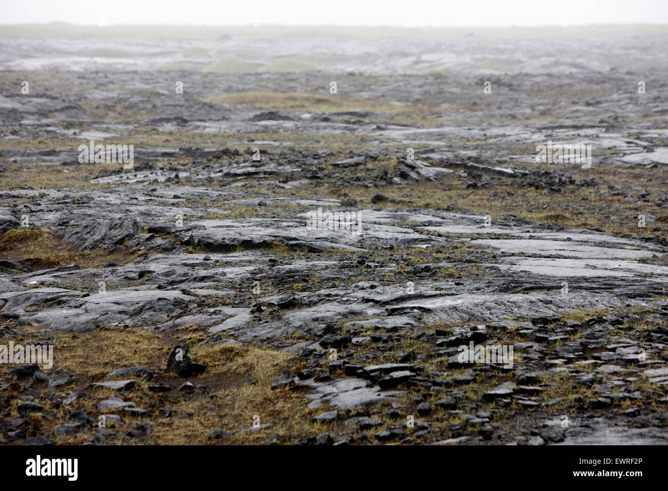 mist and rain over the lava flow landscape in southern near grindavik Iceland - Stock Image