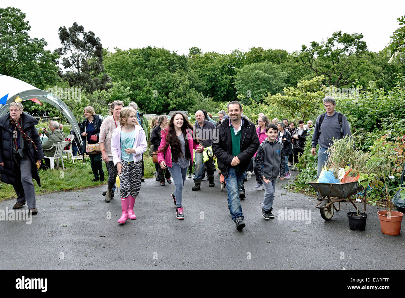 People rushing forward at the start of the plant sale Alexandra Palace Allotments London Borough of Harringay England - Stock Image