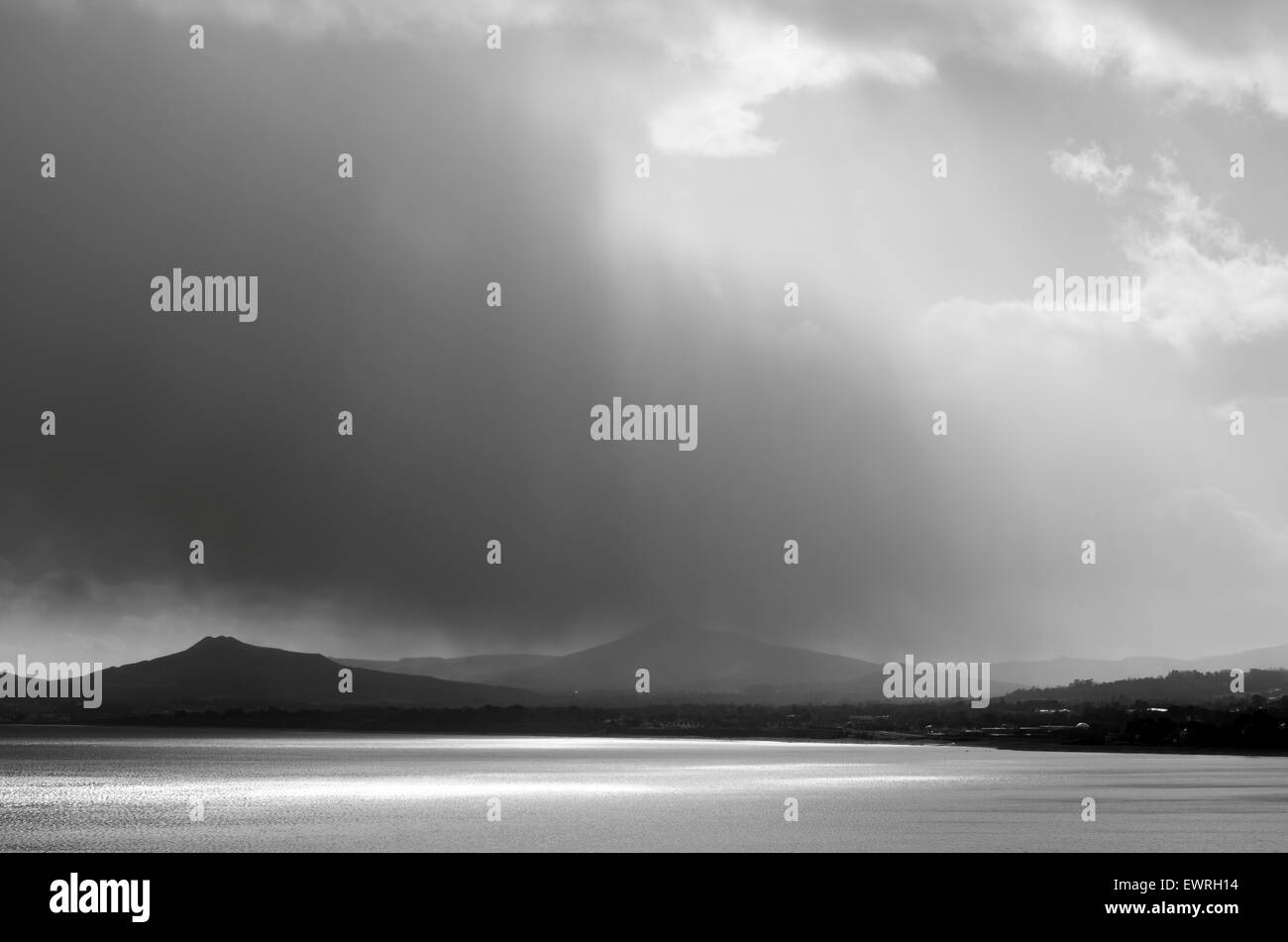 Dark raincloud appears over the Wicklow mountains,Ireland. - Stock Image
