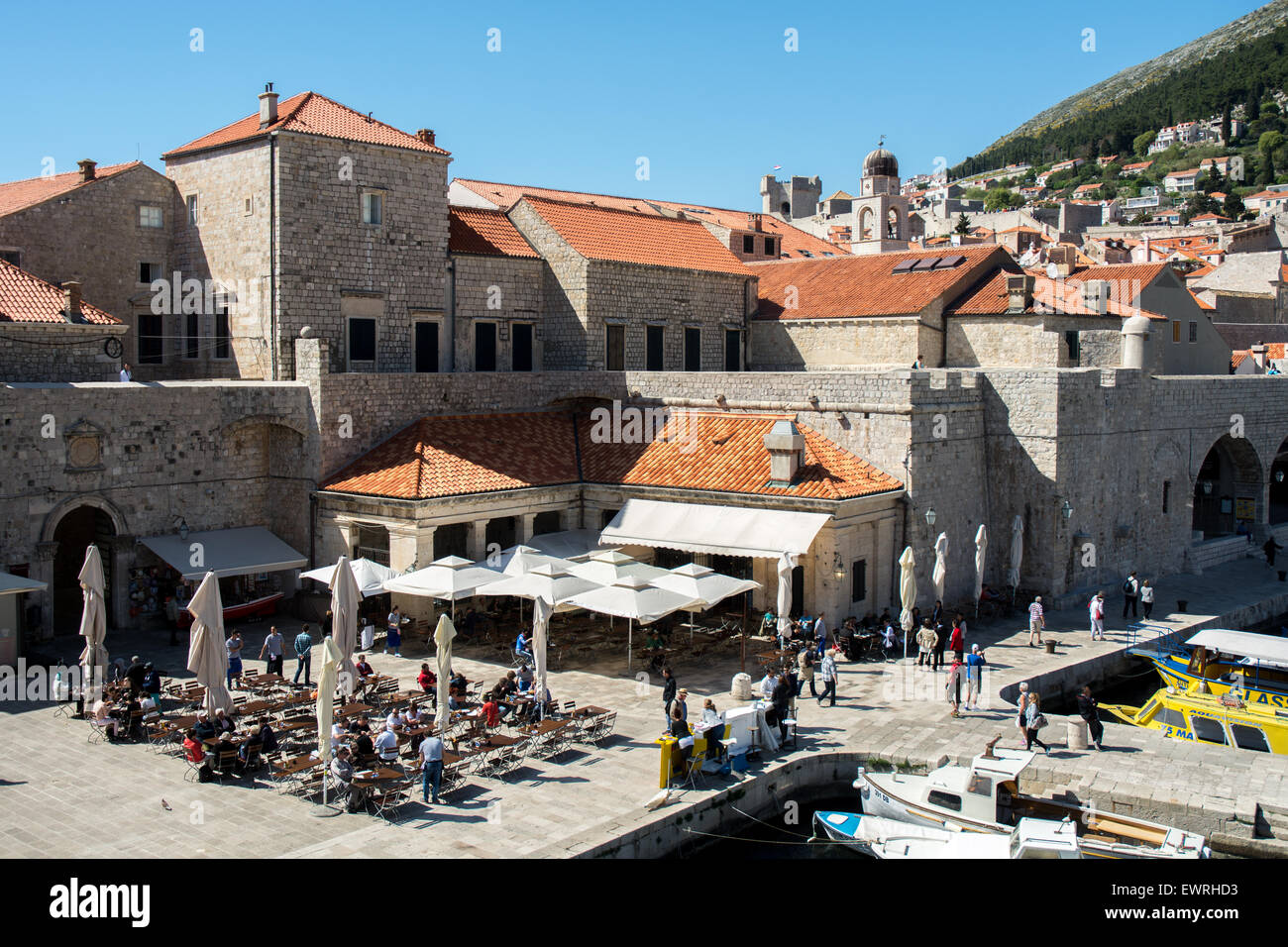 old city wall and buildings near port, dubrovnik, - Stock Image
