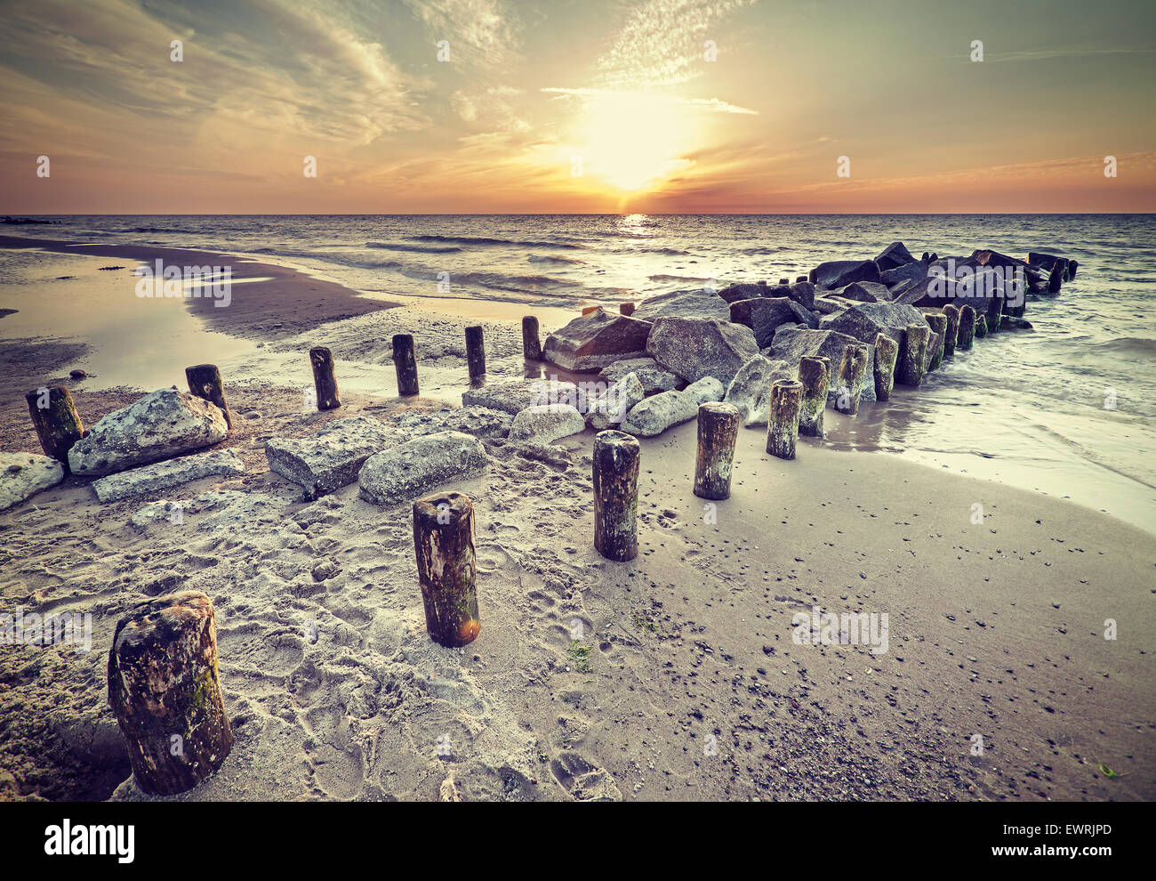 Retro vintage style beautiful sunset over Baltic Sea coast, Miedzyzdroje in Poland. Stock Photo