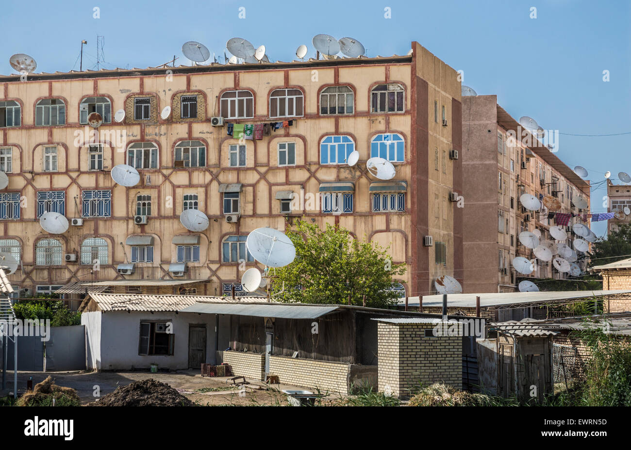 Satellite dishes sprout like mushrooms from Soviet-era apartment blocks in Mary, Turkmenistan Stock Photo