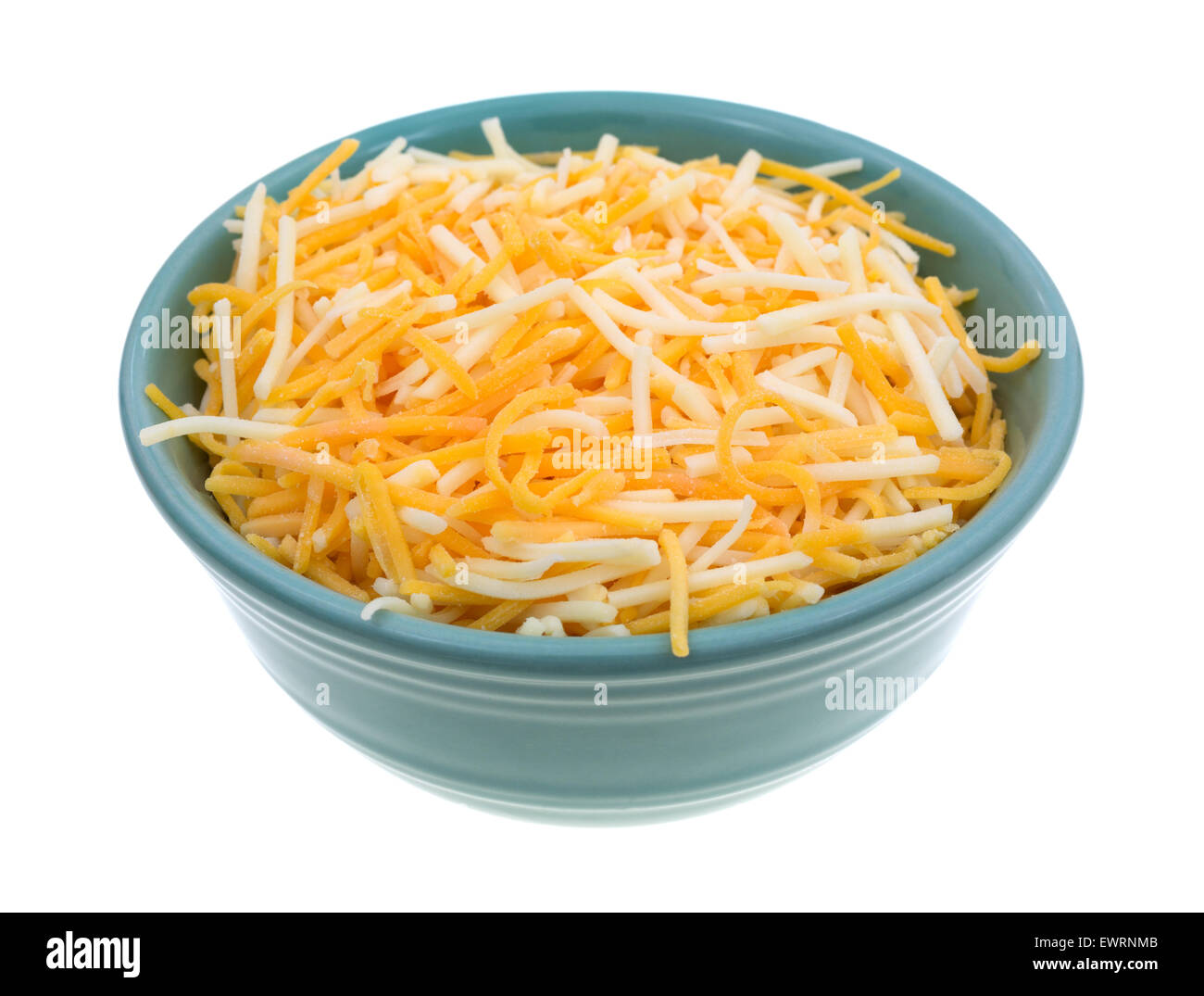 A small bowl filled with shredded white cheddar, sharp cheddar and mild cheddar cheeses isolated on a white background. - Stock Image
