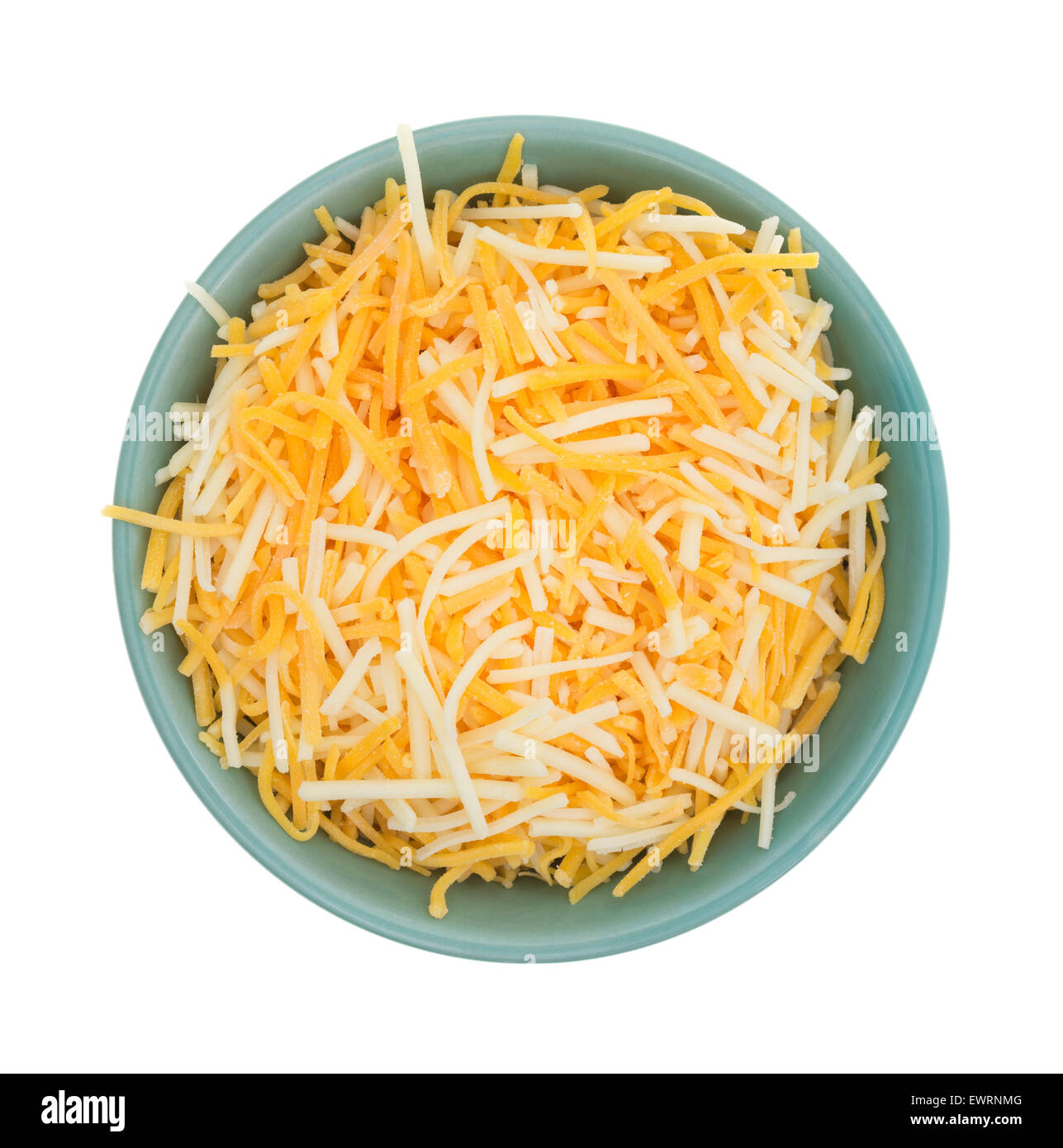 Top view of a small bowl filled with shredded white cheddar, sharp cheddar and mild cheddar cheeses - Stock Image