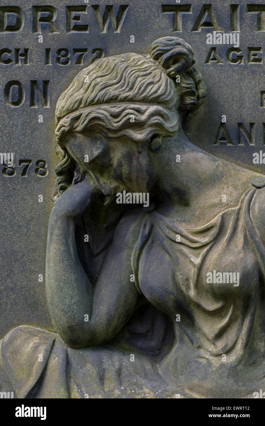 Detail from a headstone in St Cuthbert's Churchyard in Edinburgh depicting a woman in mourning. - Stock Image