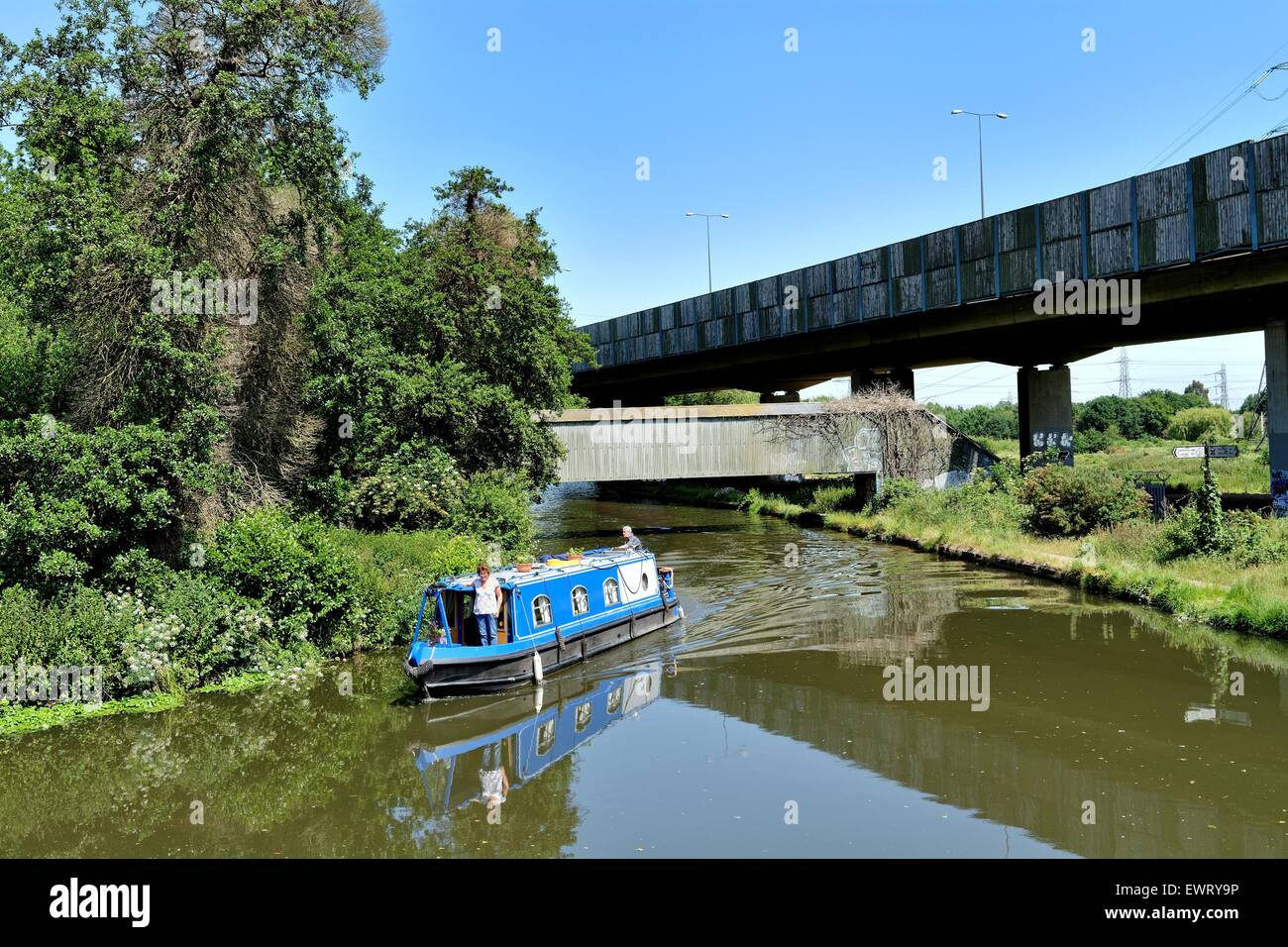 Narrow boat on the Basingstoke canal at New Haw Surrey UK - Stock Image