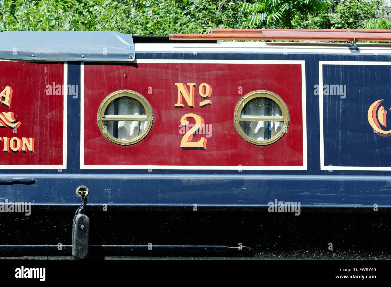 Close up of the side of a decorative narrow boat - Stock Image