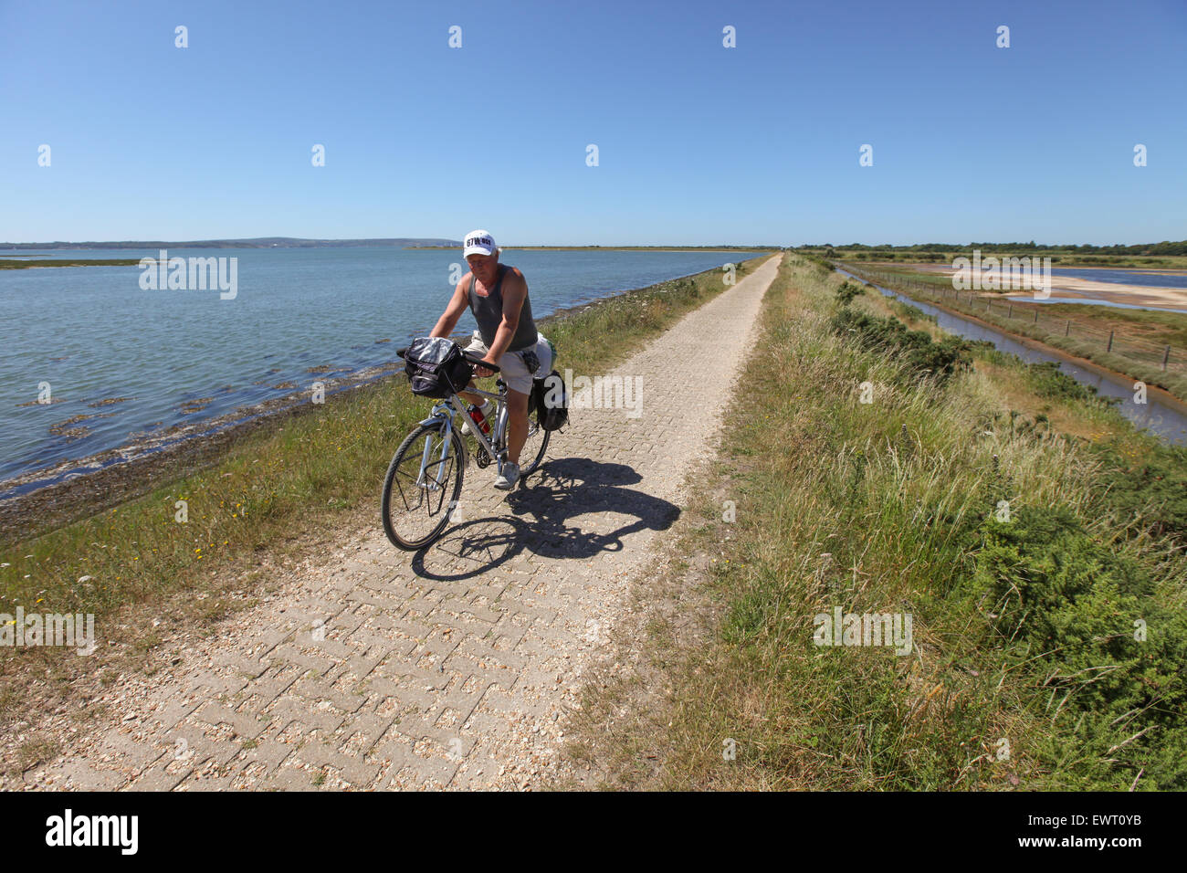 Cycling on the Solent Way between Lymington and Keyhaven - Stock Image