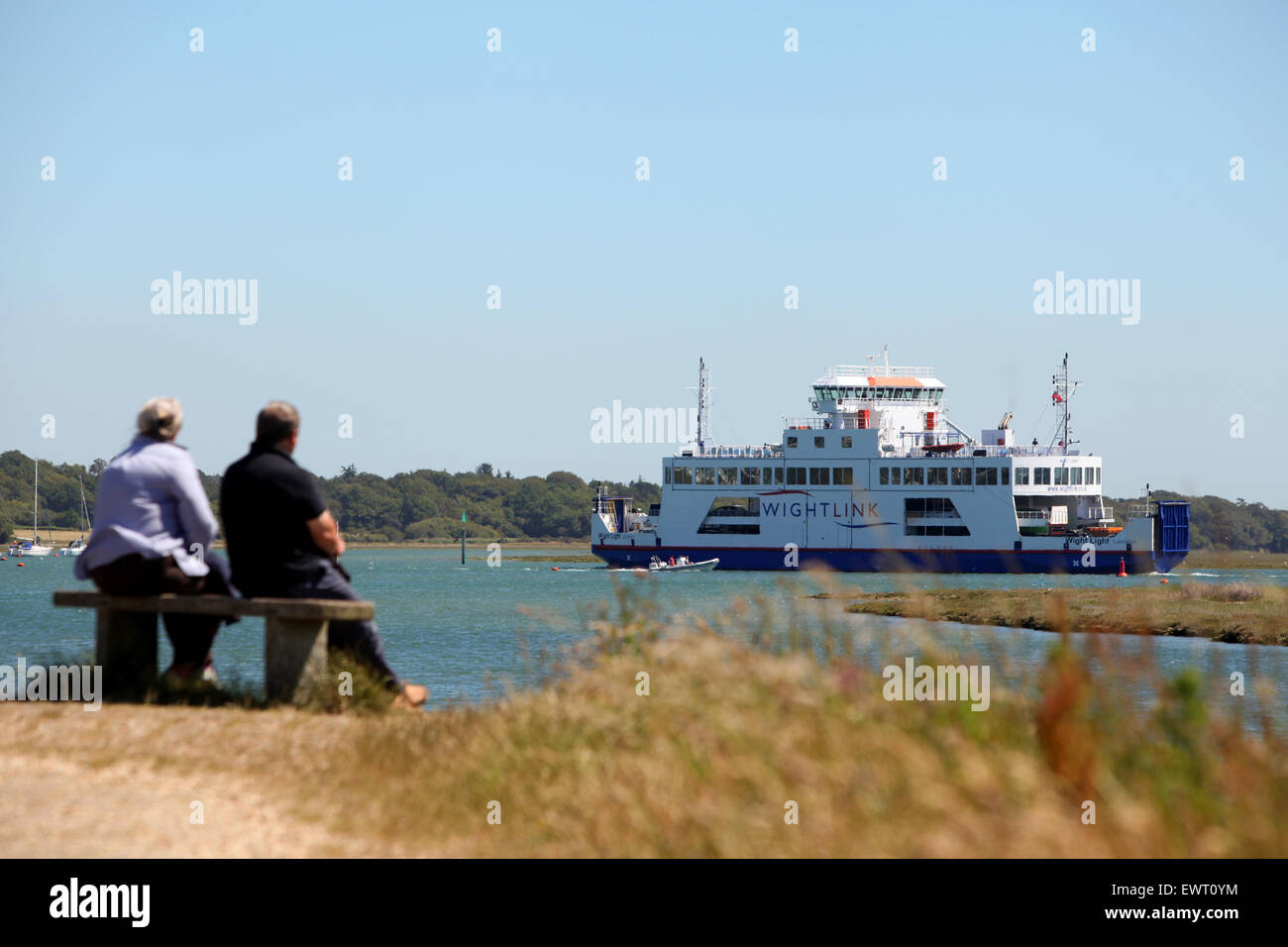 Watching the Wight Link Lymington to Yarmouth Ferry from The Solent Way in Hampshire - Stock Image