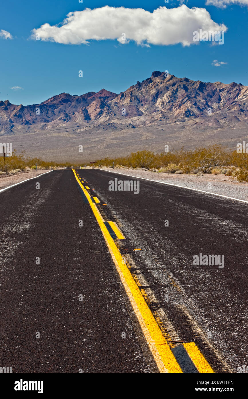 Country road leading into desert mountains (named Black Mountains) of the south part of Death Valley National Park, - Stock Image