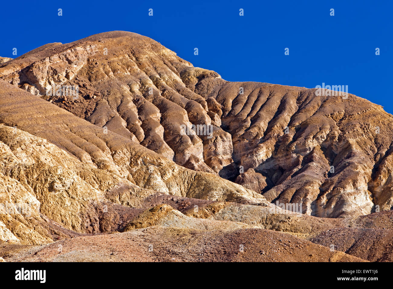 Face of Black Mountains with various colors of rock (different minerals), Along Artists Drive, Death Valley National - Stock Image