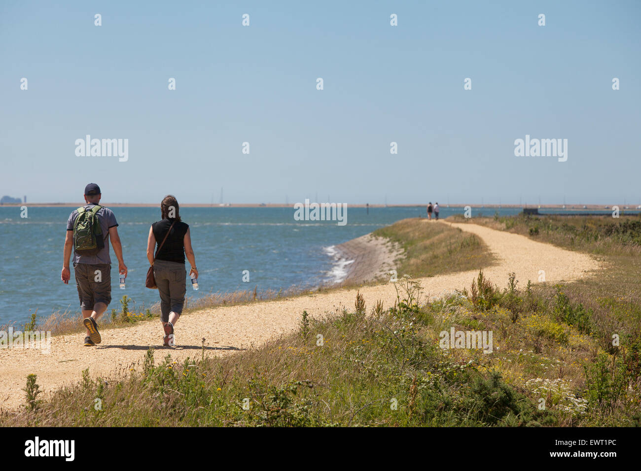 Walkers on the Solent Way between Lymington and Keyhaven - Stock Image