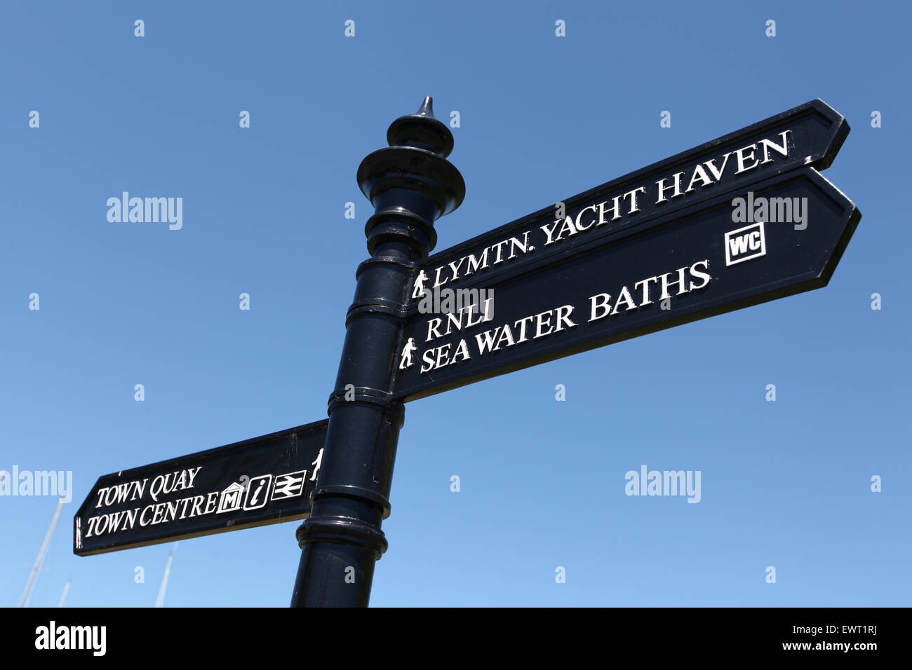 Traditional street sign in Lymington UK directing to Lymington town Quay Town Centre and the Yacht Haven - Stock Image