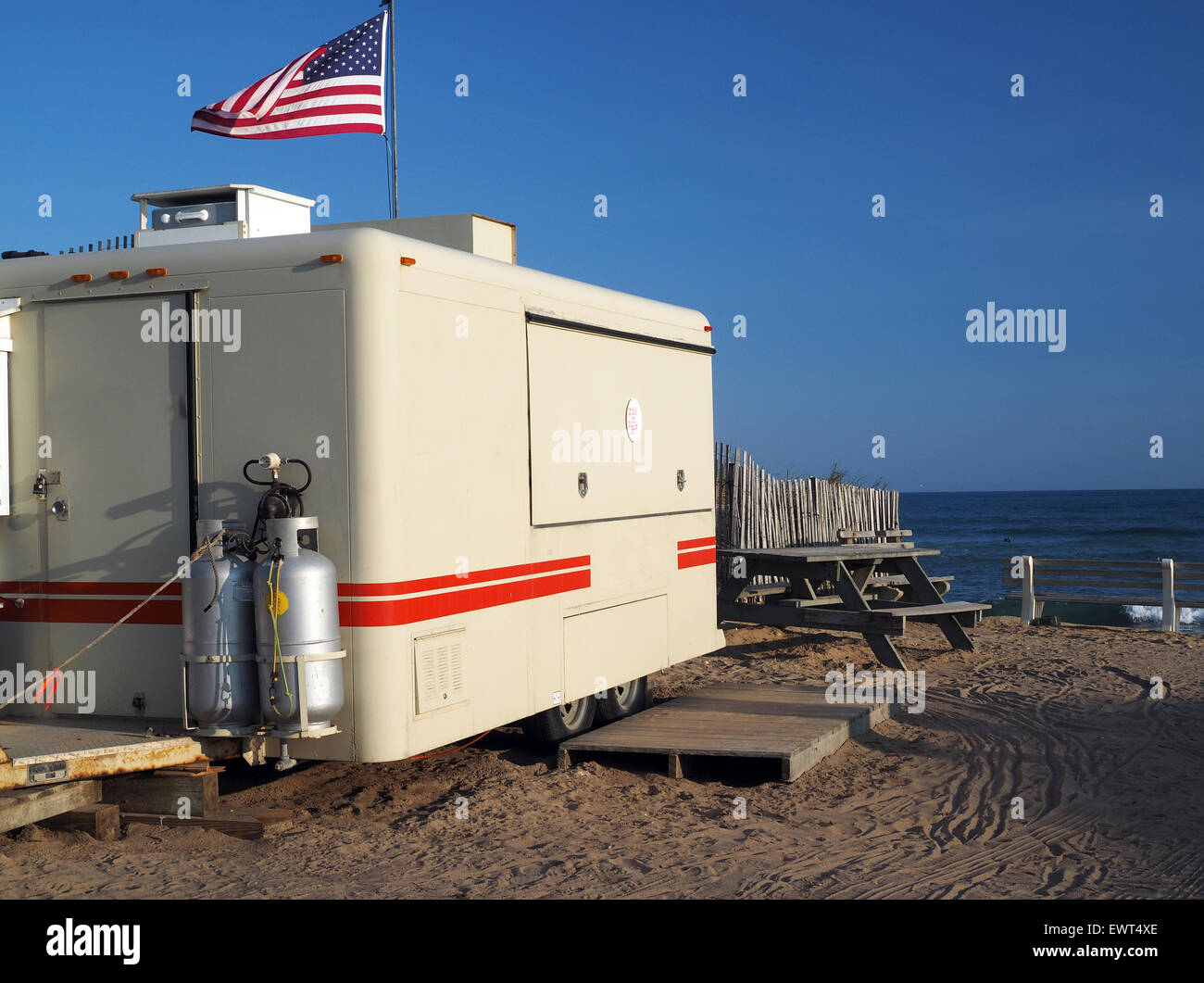 food wagon on Ditch Plains Beach Atlantic Ocean Montauk New York with American  flag blowing in wind Stock Photo