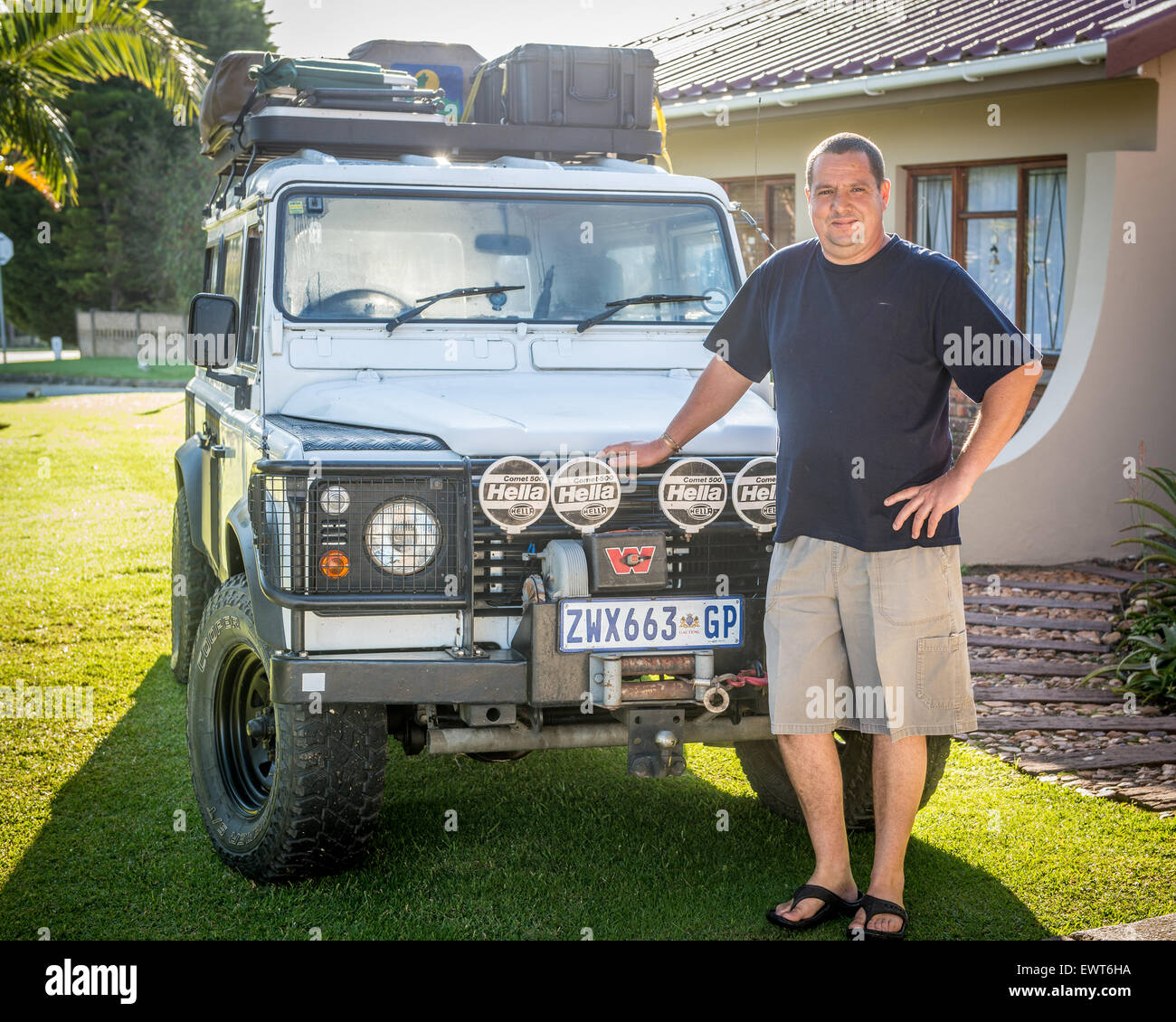 South Africa - Man standing in front of his Land Rover Defender 110